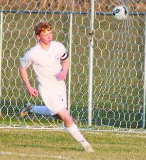 <p>Waverly-Shell Rock's Isaiah Mundell turns and jogs away from the net after scoring his first goal of the game against Clear Lake on April 17 in Waverly.</p>