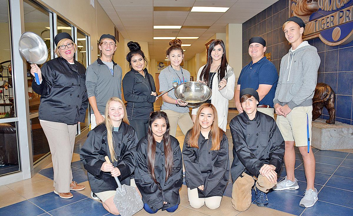 cisd gears up for bites annual prom fundraiser friday news courtesy photo members of the corsicana high school junior class prepare for the annual around the world in 80 bites junior and senior prom fundraiser