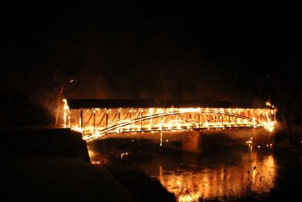 ... covered bridge over Sherman Creek caught fire early Monday morning