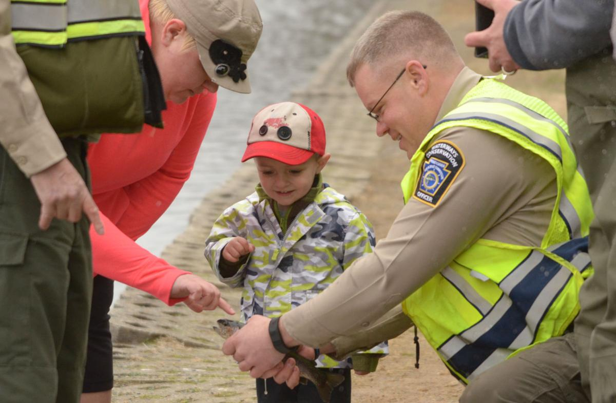 Photos children 39 s lake trout stocking photo galleries for Pa fish stocking