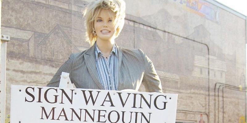 Judge candidate s waving dummy breaks danville rule news for Motorized sign waving mannequin