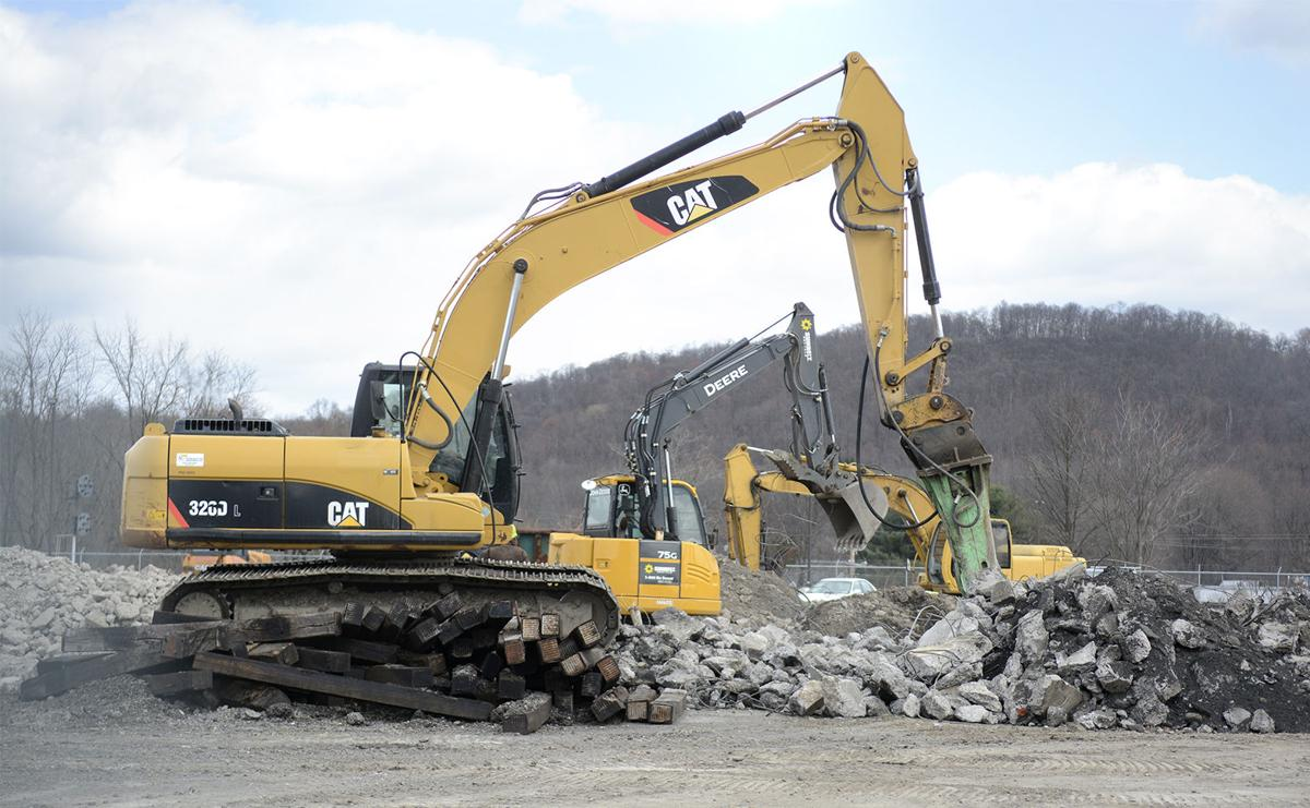 prison construction halted over cost increase news dailyitem com excavator