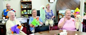 <p>Senior center members were given puppets to use for activities during a visit by Tina Baucher, a certified laughter yoga instructor.</p>