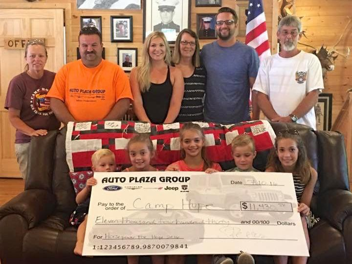 Check Presented To Camp Hope