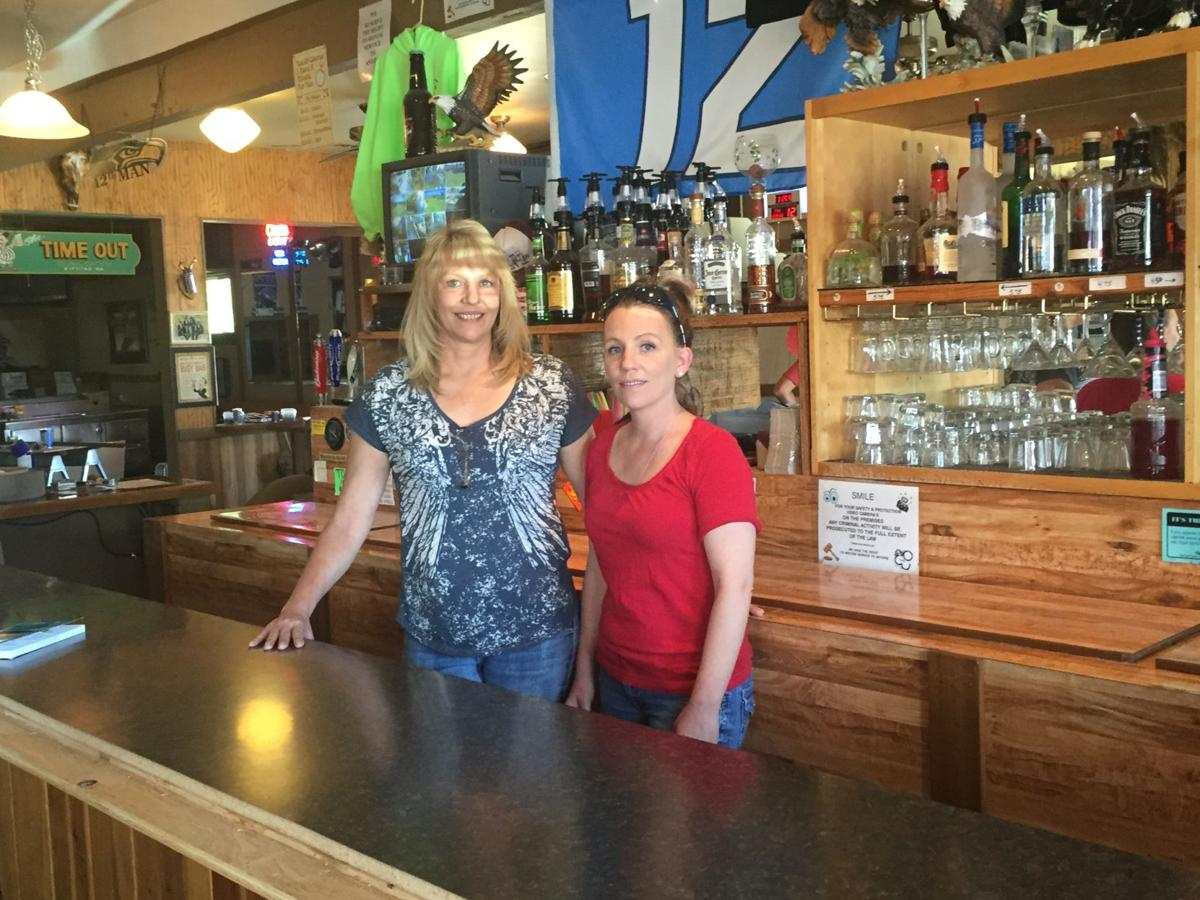 Jennifer johnson stands with her niece trishia lewis behind the bar at