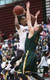 <p>Central Washington's Marc Rodgers (1) goes up for a shot against Alaska Anchorage's Brian McGill (3) during first half men's basketball action at Nicholson Pavilion, Thursday, Feb. 19, 2015. (Brian Myrick / Daily Record)</p>