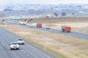 <p>Traffic moves westbound along I-90 near the interchange with I-82 near Ellensburg, Wednesday, April 2, 2014.</p>