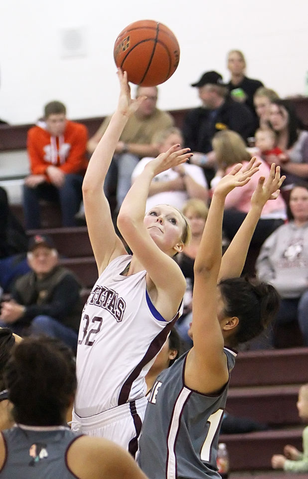 kittitas girls Tri-cities prep's talia von oelhoffen (44) shoots the ball while being guarded by kittitas's aina martinez (14) during a high school girls basketball game on friday at tri-cities prep in.