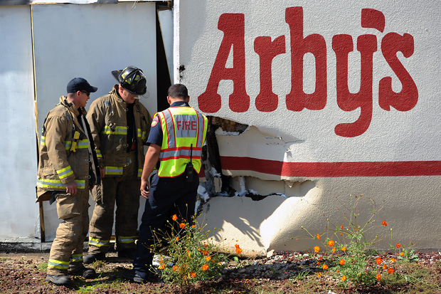 SUV Hits Arby's on University Drive