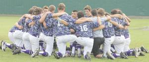 <p>Douglass baseball players huddle during a break of the Indians' series with Colmesneil in Shreveport, La.</p>