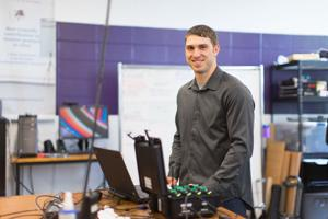 Ben Shuman, a PhD student in the Steele Lab, smiles while working with electromyography equipment (EMG). Photo credit: Liam Brozik