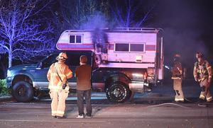 Fire damages camper in library lot