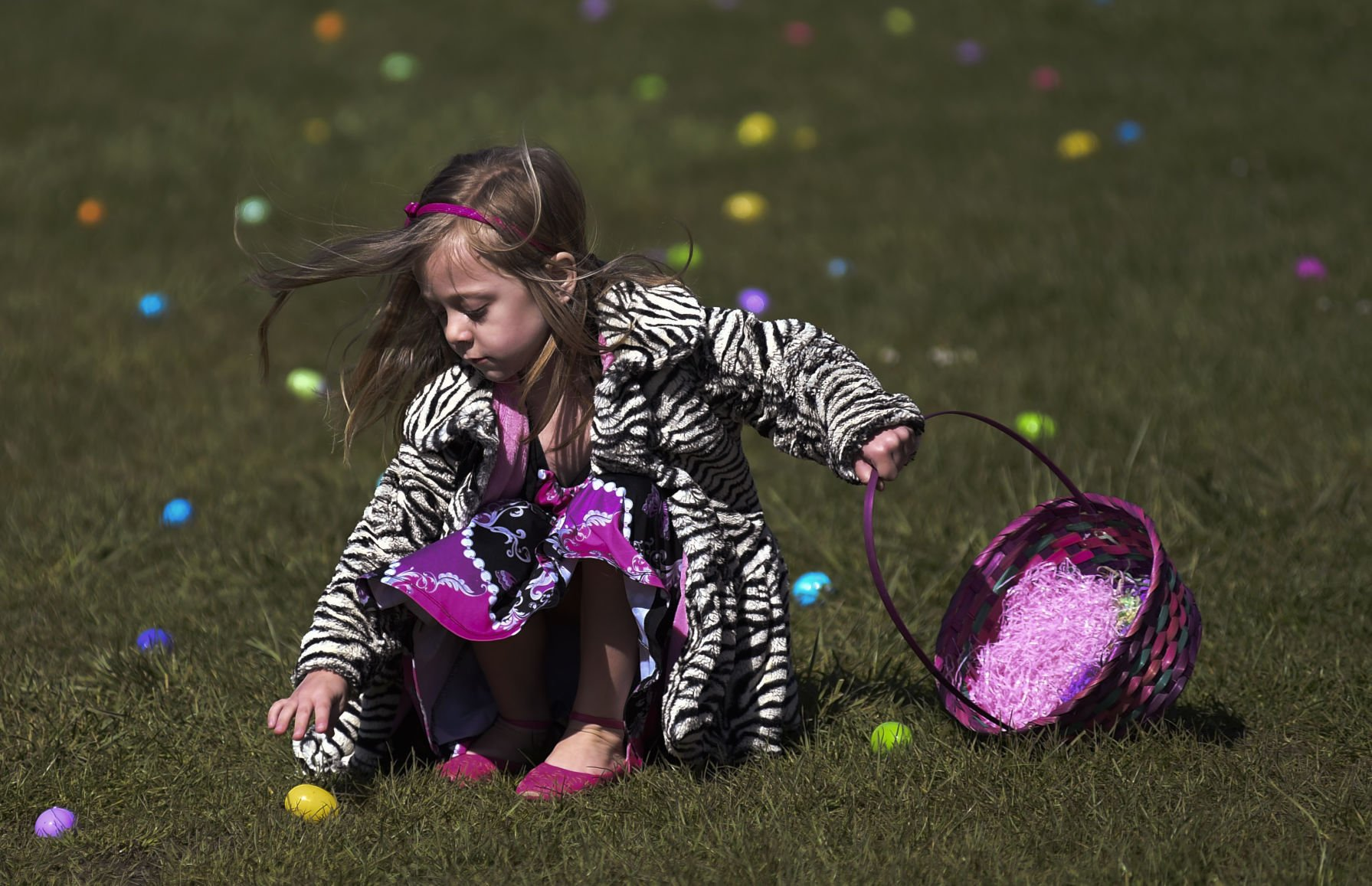 Kids listen for beeping eggs at special egg hunt