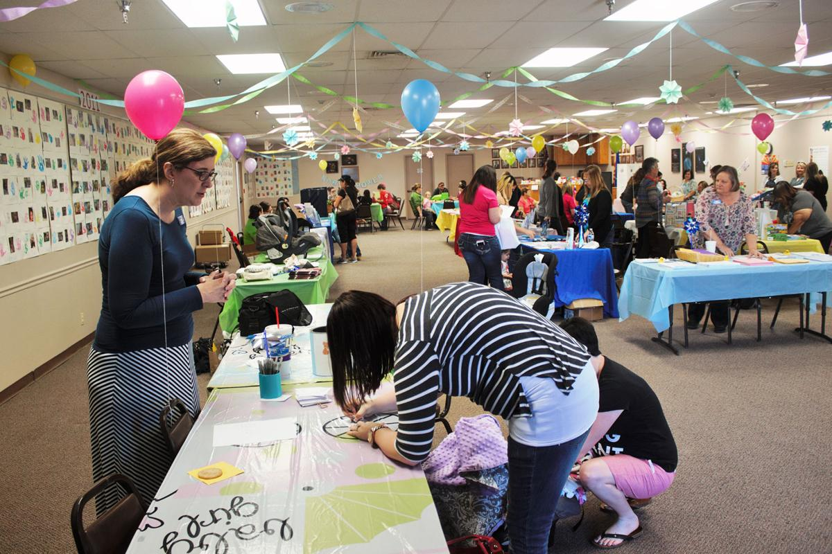 community baby shower mixes frivolity with information local news