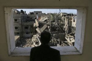 Israeli troops and tanks slice deep into Gaza