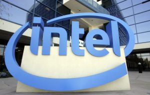 Intel profit meets subdued forecasts; revenue hits record