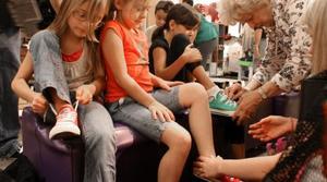 Clubs treat Q.C. kids to shopping trip