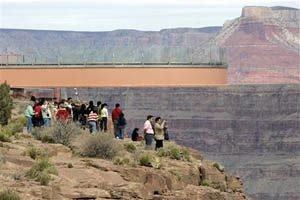 Tribe attaches massive steel bridge at edge of Grand Canyon