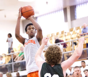 <p>Corona's Marvin Bagley III shoots the ball during the Prime Time boys basketball tournament game between Corona del Sol and Sunnyslope on Friday, June 20, 2014.</p>