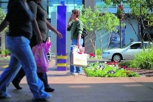Late shoppers boost holiday cheer at malls