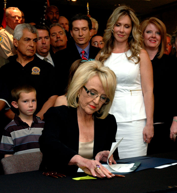 Gov. Jan Brewer signs survivor bill