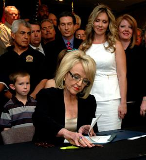 Gov. Jan Brewer signs survivor bill