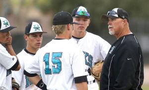 Baseball: Highland Vs Desert Vista: Highland coach Scott Cook talks with the team during the baseball game between Highland and Desert Vista at Highland High School on Wednesday, April 2, 2014. - [David Jolkovski/Tribune]