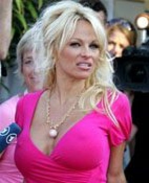 Paparazzi boo Pamela Anderson at Cannes