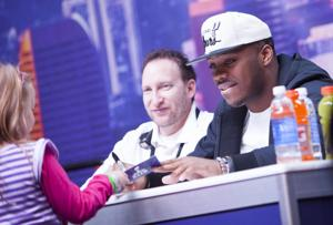 <p>Cincinnati Bengals running back Jeremy Hill signs autographs at the NFL Experience at the Phoenix Convention Center on Monday, Jan. 26, 2015.</p>