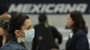 Pandemic alert raised; Mexico deaths climb