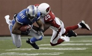 Cards hold off Lions, clinch NFC West