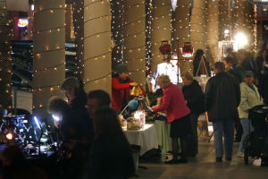 <p>Ralph Freso, Tribune -- CHANDLERARTWALK -- Visitors to the Chandler Art Walk browse over tables of handmade crafts along San Marcos Place. The event takes place every first Wednesday of the month. Jan. 7, 2009.</p>