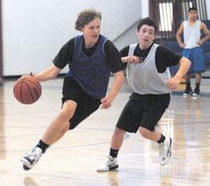 JOY ON THE COURT: New coach builds boys basketball program