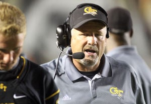 <p>Gilbert coach Tim Rutt talks on a headset while taking on Skyline, Friday, Sept. 20, 2013 in Gilbert. [Tim Hacker/Tribune]</p>