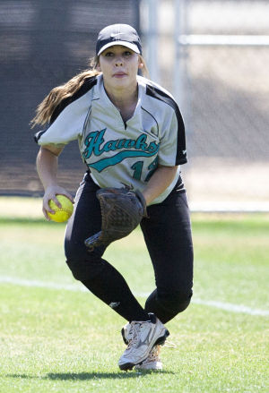 Softball: Highland Vs Desert Vista: Highland's Bailey Beach (12) catches the ball during the softball game between Highland and Desert Vista at Highland High School on Saturday, May 3, 2014. - [David Jolkovski/Tribune]