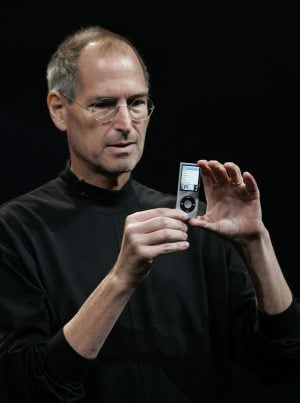 Apple unveils newest line of iPods, but shares slip