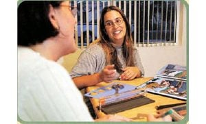 Scrapbooking lets women connect in the present, preserve the past