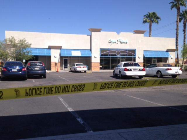 Car hits Gilbert business; kills 1