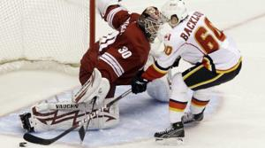 Coyotes blow lead but top Flames in shootout