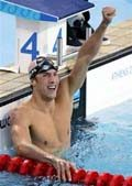 Phelps captures gold, sets world record
