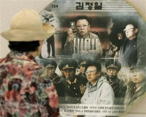 N. Korea boots inspectors, vows to restart reactor