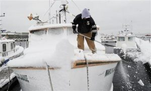 Storm blankets snow across Midwest, New England