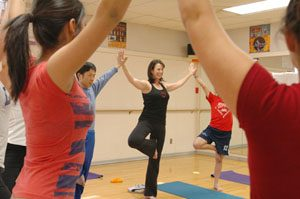 Gilbert woman bends stress with yoga