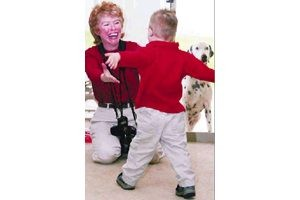 Photographer develops keys to photographing special needs children