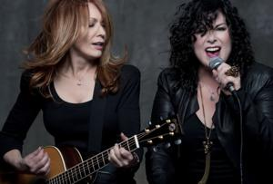 Sisters Nancy (red hair) and Ann (black hair) Wilson of the band Heart