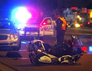 Motorcycle officer injured in Chandler crash