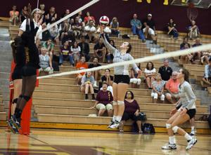 <p>Hamilton's Carley Bock (15) hits the ball during the volleyball match between Mountain Pointe and Hamilton at Mountain Pointe High School on Wednesday, Sept. 10, 2014.</p>