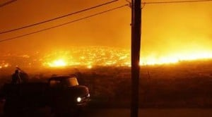 Thousands flee raging wildfires in Greece