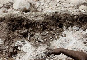 Doctors worried as Haiti's mass graves swell