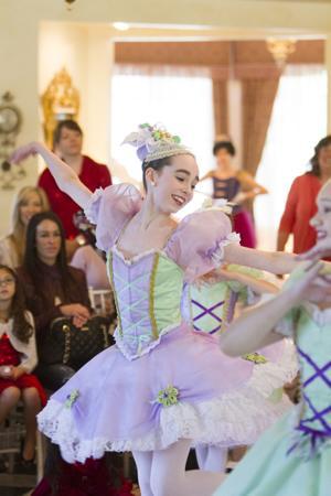 """<p>Mia Domini performs as the Bon Bon Fairy during the Ballet Etudes """"Nutcracker Sweet Tea"""" at The Wright House in Mesa on Saturday, Nov. 22, 2014.</p>"""